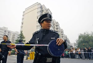 Liu Xiaobo Nobel Peace: Chinese police officer seals off a road near Liu Xia's apartment