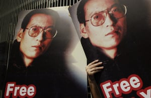 Liu Xiaobo Nobel Peace: Pro-democracy activists hold pictures of Chinese dissident Liu Xiaobo