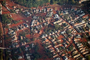 Toxic Spill Update: Aerial view shows houses affected by a toxic red sludge