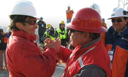The Chilean mining minister, Laurence Golborne (left) greats a Plan B driller after the breakthrough