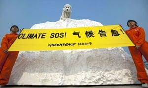 Greenpeace activists hold a banner outside the Tianjin climate talks