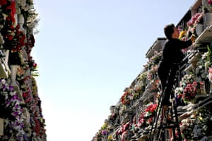 All saints day: A woman lays flowers for her beloved ones at the cemetery in Algeciras