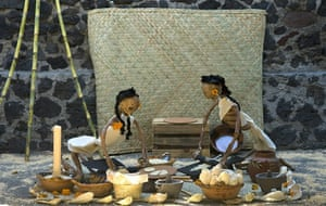 All saints day: Two paper skeletons as representation of people cooking Mexican tortilla