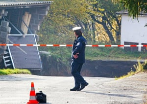 Germany sinkhole: A member of the emergeny services works at the scene