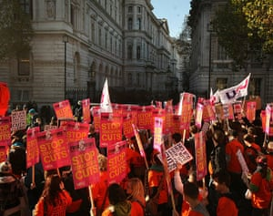 Students protest: Students hold placards as they march past Downing Street in London