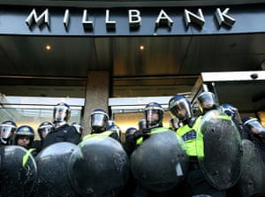 Students protest: Riot police outside Millbank Tower, in Westminster