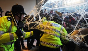Students protest: Police struggle with students as they try to break into Millbank