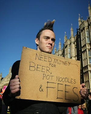 Students and slogans: Need Money for Beer - a placard outside Parliament