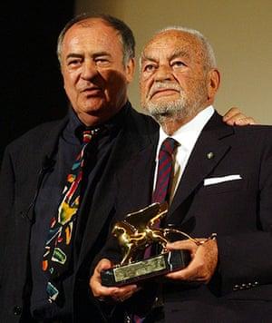 Dino Di Laurentiis: Dino de Laurentiis, right, holds the Golden Lion awarded for his career