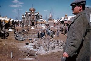 Dino Di Laurentiis: Dino De Laurentiis standing on the set of his film Tempest in 1958