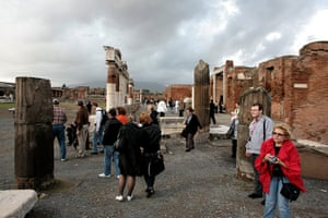 Pompei Ruins Collaps: Tourists at The Forum, Mount Vesuvius in the clouds Italy
