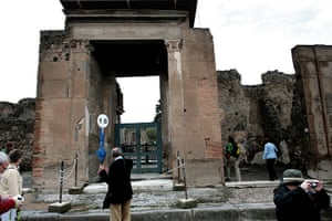 Pompei Ruins Collaps: Guide and tourists at entrance to House of the Faun, Pompei, Italy