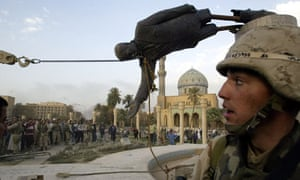 Saddam Hussein's statue in Baghdad is pulled down by Iraqi civilians and US soldiers