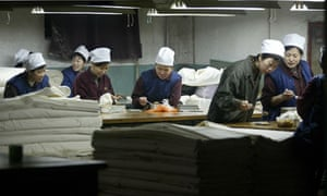 Workers at the Shijiazhuang Textile Factory eat lunch