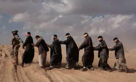 Iraqi detainees held while they wait to be taken for questioning