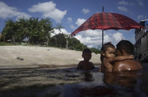 From the agencies: Bare tribe man swims with his children in Santa Isabel do Rio Negro