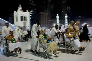 Hajj In Mecca: Elderly and walk-impaired Muslim pilgrims circle the Kaaba