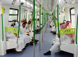 Hajj In Mecca: Saudi Arabian men ride on the newly-opened Holy Sites metro light railway