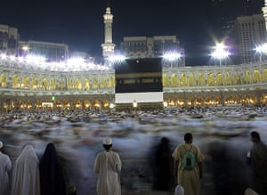 Hajj In Mecca: Muslim pilgrims moving around the Kaaba, the black cube Mecca