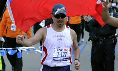 Chilean miner Edison Pena crosses the finish line