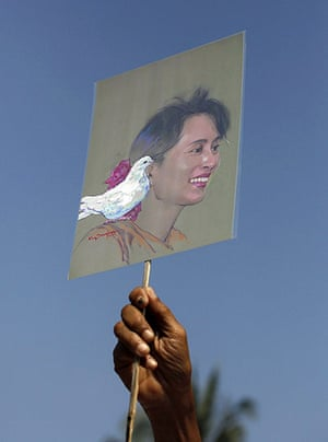 Suu Kyi Release: A National League for Democracy member with a sketch of Aung San Suu Kyi