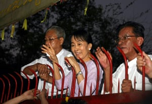 Suu Kyi Release: Aung San Suu Kyi waves to supporters outside her house after her release