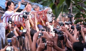 Burmese pro-democracy leader Aung San Suu Kyi greets supporters after her released from house arrest