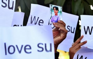 Aung San Suu Kyi release : Supporters hold up a pictures and signs of Aung San Suu Kyi