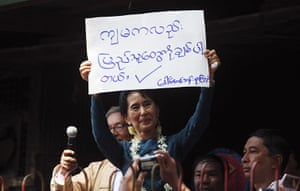 Aung San Suu Kyi release : Aung San Suu Kyi holds a sign in Yangon