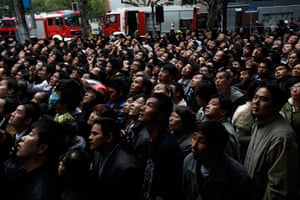 Shanghai fire: a crowd of people watch the burning building