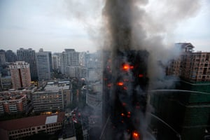 Shanghai fire: Firefighters spray water on the burning building