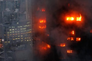 Shanghai fire: flames light up the windows of the burning building