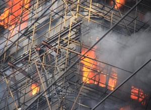 Shanghai fire: a person waits for rescue in the burning building
