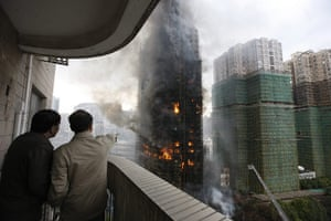 Shanghai fire: nearby residents watch the blaze from the safety of their own home
