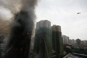 Shanghai fire: firemen spray water on the flames