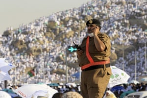 Hajj in Mecca: A member of Saudi security forces stands guard on the plains of Arafat