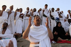 Hajj in Mecca: Muslim pilgrims pray on a rocky hill called the Mountain of Mercy