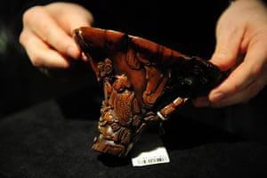 rhinoceros : A rhinoceros horn carving is displayed d