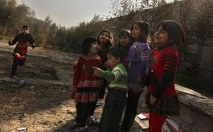 Eid al-Adha: Afghan children watch as butchers, unseen, slaughter a sheep