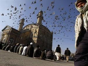 Eid al-Adha: Afghan men wait to perform Eid al-Adha prayers at a mosque in Kabul