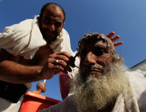 Hajj Pilgimage: A Muslim pilgrim has his head shaved