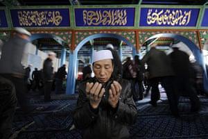 Eid al-Adha: A Muslim man prays on the festival of Eid al-Adha in Yinchuan