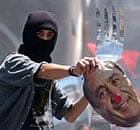 A demonstrator holds a mask of the Argentinian president during a protest in Buenos Aires, 2002.