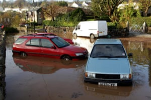cornwall flooding: Cars which have been washed down a road in Lostwithiel