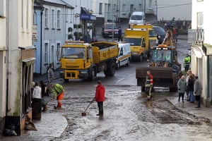 cornwall flooding: Council workers clean the flooded streets in Lostwithiel