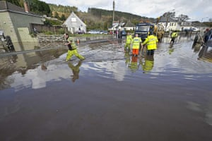 cornwall flooding update: Workmen try to clear a drain in St Blazey