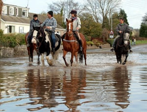 cornwall flooding update: Residents get about on horseback to avoid flooded streetsin St Blazey