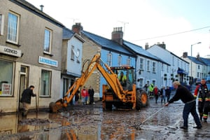 cornwall flooding update: Clear up operation on the A390 main road through Lostwithiel