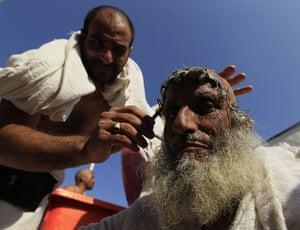 Eid al-Adha: A Muslim pilgrim has his head shaved