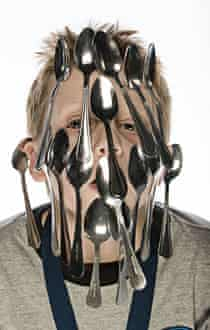 Aaron Caissie from Canada can balance 17 spoons on his face.
